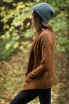 Gorgeous, fingering weight long cardigan with pockets and honeycomb detailing on the back panel.