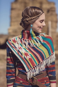 Southwest is in. Using Intarsia and fun striping sequences you will love this triangle shawl. So many color options!!